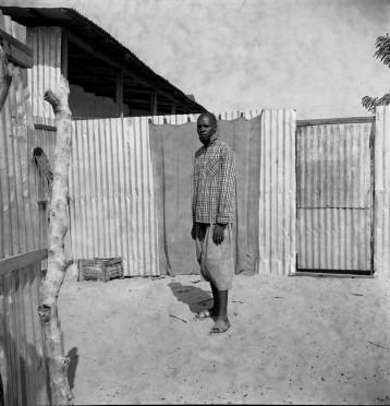 9. Man Standing in a Courtyard_Oumar Ka